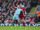 Ashley Barnes and Ragnar Klavan in action during the Premier League game between Liverpool and Burnley on March 12, 2017