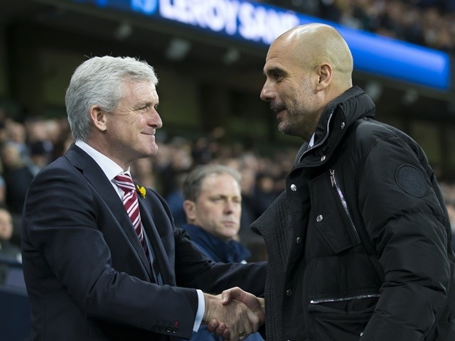 Pep Guardiola greets Mark Hughes ahead of the Premier League match between Manchester City and Stoke City on March 8, 2017