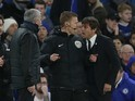 Mike Jones stands between Jose Mourinho and Antonio Conte during the FA Cup quarter-final between Chelsea and Manchester United on March 13, 2017