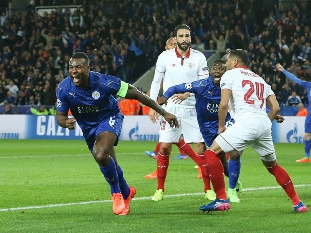 Leicester City's Wes Morgan celebrates scoring against Sevilla in the Champions League on March 14, 2017