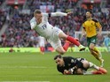 Jamie Vardy makes a flying leap over Ernestas Setkus during the World Cup qualifier between England and Lithuania on March 26, 2017
