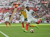 Ryan Bertrand and Fiodor Cernych in action during the World Cup qualifier between England and Lithuania on March 26, 2017