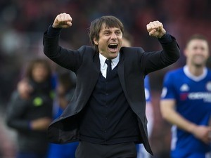 Antonio Conte is happy during the Premier League game between Stoke City and Chelsea on March 18, 2017