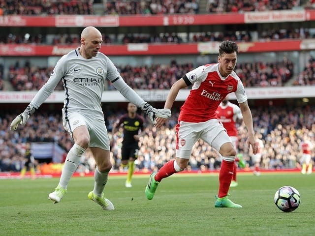 Arsenal's Mesut Ozil and Manchester City's Wilfredo Caballero in action on April 2, 2017