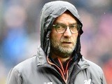 A hooded Jurgen Klopp looking shifty during the Premier League game between West Bromwich Albion and Liverpool on April 16, 2017