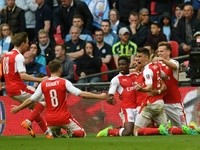 Arsenal players celebrate Alexis Sanchez's goal against Manchester City in the FA Cup semi-final on April 23, 2017