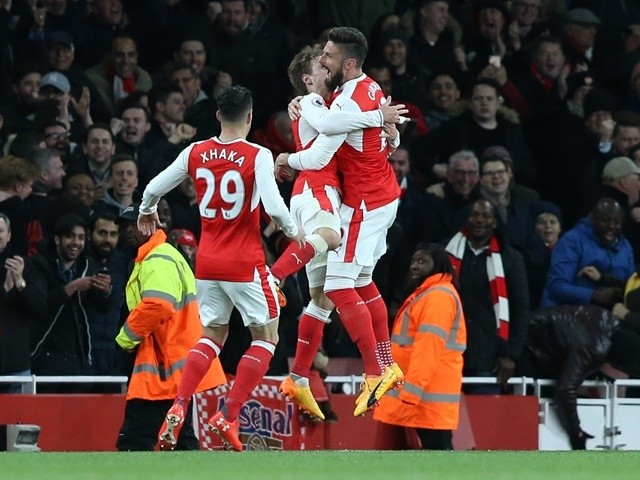 Arsenal players react to Robert Huth's own goal in the Premier League match against Leicester City on April 26, 2016