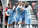 Geoff Cameron celebrates with teammates after opening the scoring during the Premier League game between Bournemouth and Stoke City on May 6, 2017