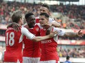 Arsenal midfielder Granit Xhaka celebrates with teammates after opening the scoring during his side's Premier League clash with Manchester United at the Emirates Stadium on May 7, 2017