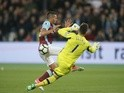 Tottenham Hotspur's Hugo Lloris saves from West Ham United's Manuel Lanzini on May 5, 2017