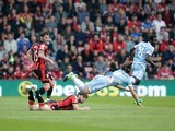 Harry Arter takes out Joe Allen during the Premier League game between Bournemouth and Stoke City on May 6, 2017