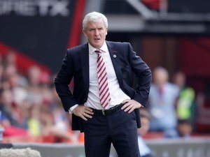 Mark Hughes watches on during the Premier League game between Bournemouth and Stoke City on May 6, 2017