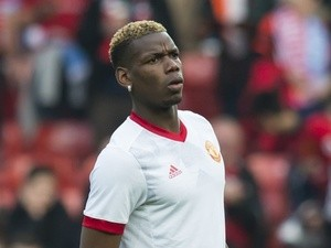 Manchester United midfielder Paul Pogba warms up ahead of the Europa League match against Celta Vigo on May 11, 2017