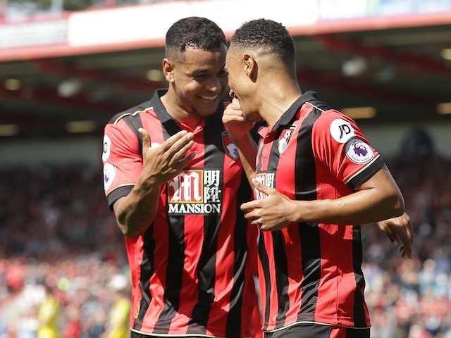 Joshua King congratulates Junior Stanislas during the Premier League game between Bournemouth and Burnley on May 13, 2017