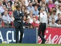 Antonio Conte and windswept Arsene Wenger during the FA Cup final between Arsenal and Chelsea on May 27, 2017