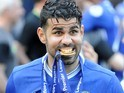 Diego Costa eats his medal during the Premier League game between Chelsea and Sunderland on May 21, 2017