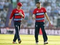Eoin Morgan and Mark Wood of England during the T20 against South Africa on June 21, 2017