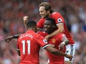 Paul Pogba celebrates with Anthony Martial and Daley Blind after scoring during the Premier League game between Manchester United and West Ham United on August 13, 2017