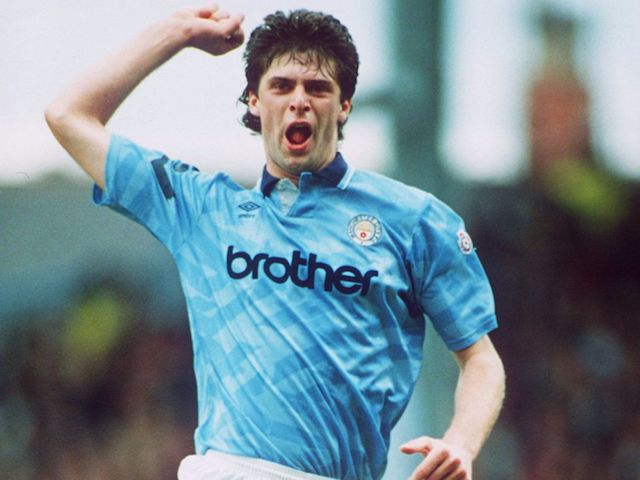 Niall Quinn in action for Manchester City