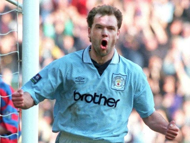 Uwe Rosler in action for Manchester City