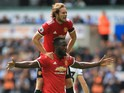 Daley Blind mounts Romelu Lukaku during the Premier League game between Swansea City and Manchester United on August 19, 2017