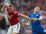 Phil Jones and Jamie Vardy in action during the Premier League game between Manchester United and Leicester City on August 26, 2017