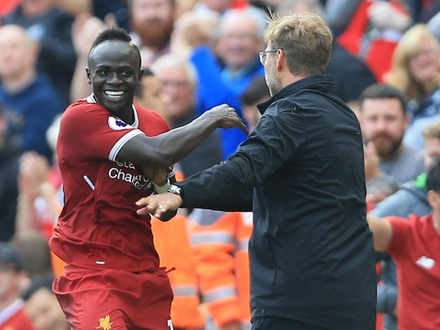 Sadio Mane celebrates with Jurgen Klopp during the Premier League game between Liverpool and Crystal Palace on August 19, 2017