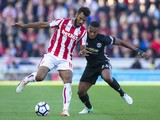 Eric Maxim Choupo-Moting and Antonio Valencia in action during the Premier League game between Stoke City and Manchester United on September 9, 2017
