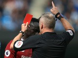 Jon Moss hands Sadio Mane a red card during the Premier League game between Manchester City and Liverpool on September 9, 2017