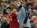 Liverpool manager Jurgen Klopp speaks to Philippe Coutinho during their Champions League Group E clash with Sevilla at Anfield on September 13, 2017