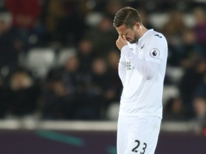 Swansea City midfielder Gylfi Sigurdsson in action during his side's Premier League clash with Bournemouth at the Liberty Stadium on December 31, 2016